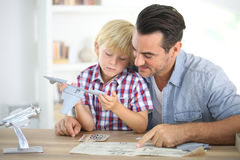Father and child constructing a plane toy Stock Photo