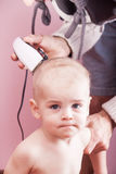 The father of the child cuts clipper. Stock Photography