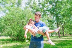 Father and child girl playing together. Father`s day concept. Dad is holding his daughter in his arms royalty free stock images