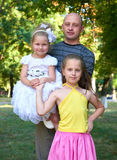 Father and child girl posing on outdoor in city park, summer season Stock Image