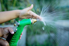 Father and child hand help watering plant in garden Royalty Free Stock Photos