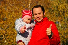 Father with child on hands Royalty Free Stock Images