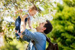 Father with child have a leisure flowering garden Stock Photos