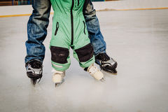 Father and child learning to skate in winter Stock Photos