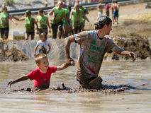 Father and child in the mud stock photography