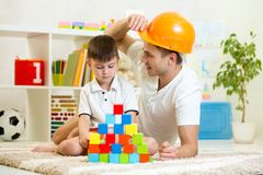 Father and child play construction game together. Father and child playing construction game together at home Stock Images