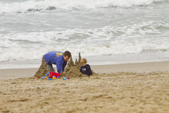 Father and Child Playing on Beach Stock Photo