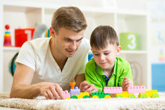 Father and child playing construction game. Father and child boy playing construction game together at home Royalty Free Stock Photo