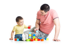 Father and child playing construction game together Royalty Free Stock Photo