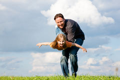 Father and child playing together Stock Photography