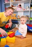 Father and child in playroom 2 Royalty Free Stock Image