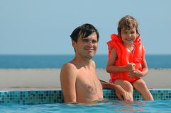 Father with child in pool Stock Photo