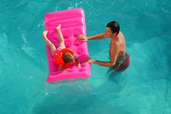 Father and child in pool Royalty Free Stock Photography