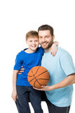 Father and child ready to play basketball and looking at camera Royalty Free Stock Photography