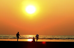 Father and  child by the sea shore, sunset Stock Photo
