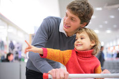 Father with child in  shop Royalty Free Stock Photo