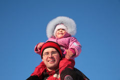 Father with child on shoulders in winter Stock Photo