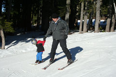 Father and child skiing. Fathwer and child having fun skiing Stock Photo