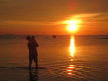 Father and child, sunset on beach thailand Stock Photos