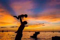 Father and child on sunset sea background Royalty Free Stock Photo