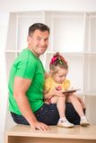Father and child using electronic tablet at home Royalty Free Stock Photos