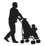 Father with child01. Father walking with a baby in a stroller Royalty Free Stock Photography