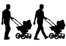Father with child. Father walking with a baby in a stroller Royalty Free Stock Images