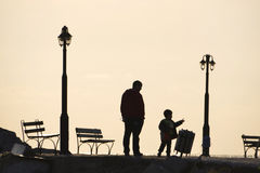 Father and child walking at pier. Molivos harbor Lesvos royalty free stock images