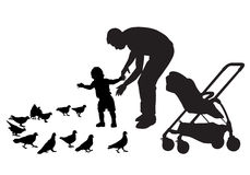 Father with child. Father walks with the baby in the stroller. They feed the pigeons. The child learns to walk. Father protects the child. Silhouette on a white Royalty Free Stock Photo