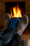 Father And Child Warming Feet By Fire Royalty Free Stock Images