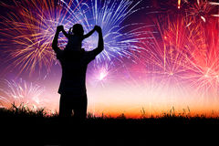 Father with child watching the firework royalty free stock photos