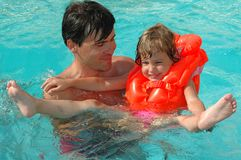 Father with child in water. Father with child have fun in water pool Royalty Free Stock Image