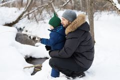 Father and child in a winter forest Stock Photography