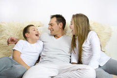 Father with children. Happy family siting on couch Royalty Free Stock Photography