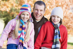 Father and children on autumn walk. Sitting on fence Royalty Free Stock Photo