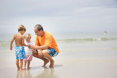 Father and children on beach Royalty Free Stock Images