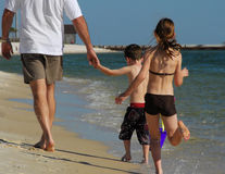 Father and children at beach. Father, son, and daughter having fun on beach stock photos