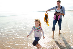 Father with Children on Beach Stock Image