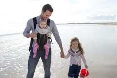 Father with Children on the Beach Royalty Free Stock Photography