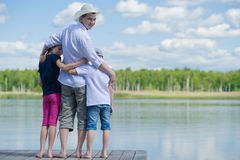 Father with children came to rest on the lake Stock Photos