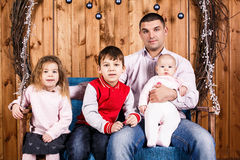 Father with children on christmas holiday Royalty Free Stock Photography