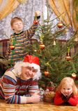 Father and children with christmas tree Royalty Free Stock Images