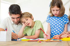 Father and children coloring. At home Stock Photo