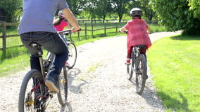 Father And Children On Cycle Ride In Countryside stock footage