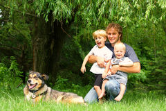 Father with Children and Dog Outside Royalty Free Stock Photo