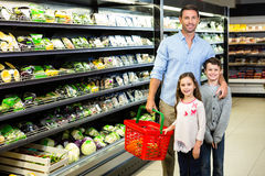 Father and children doing grocery shopping Royalty Free Stock Image