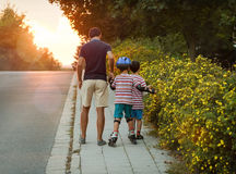 Father with children on evening walk Royalty Free Stock Image