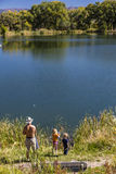 Father and children are fishing South of Montrose Colorado, off the Uncompahgre, on Chipeta Lakes, Montrose, Colorado. September, Stock Image