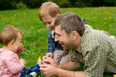 Father and children in garden Royalty Free Stock Images