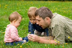 Father and children in garden Royalty Free Stock Photo